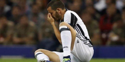 Juventus' Leonardo Bonucci sits on the floor injured